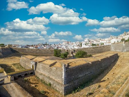 Elements of a fortification: aerial view of a triangle share ravelin or demi lune with a sentry box in the ditch between 2 bastions in Elvas Portugal, the structure adds additional defense to the gate