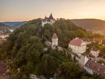 Aerial panorama view of site Sighisoara in Transylvania, Romania towers, city walls, gates and bastions