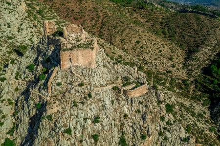 Aerial view of medieval Gothic Borriol hilltop castle ruin near Castellon Spain with blue sky