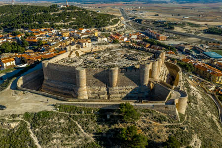 Aerial view of Chinchilla de Montearagon castle with ruined excavated inner building remains surrounded by an outer wall with semi circular towers