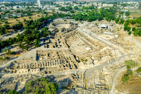 Aerial view of ancient Beit Shean ruins of a Roman Byzantine era settlement in Israel with blue sky