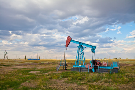 natural gas prices: Oil pump on a background of a stormy sky