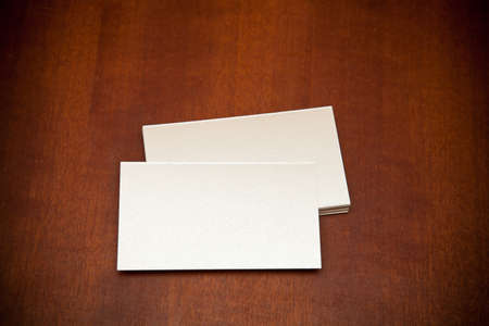 blank business card on a wooden background photo