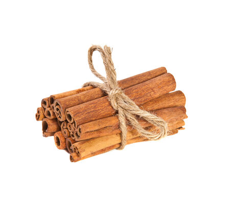 related: related cinnamon sticks on white background Stock Photo