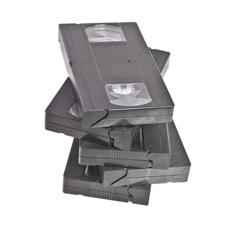 Stack of old VHS tapes on a white background