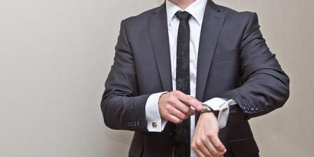 cuff link: Man shows at clock