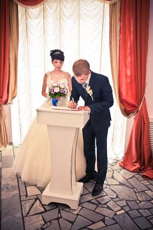 registry: groom write on registration of marriage Stock Photo