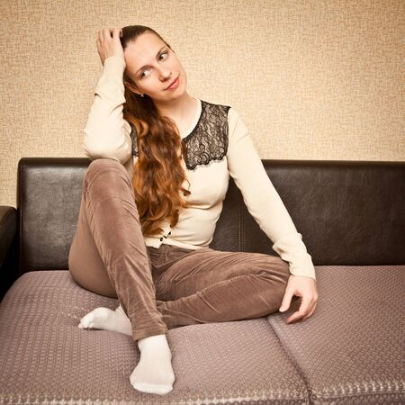 sock: young girl sitting on the couch