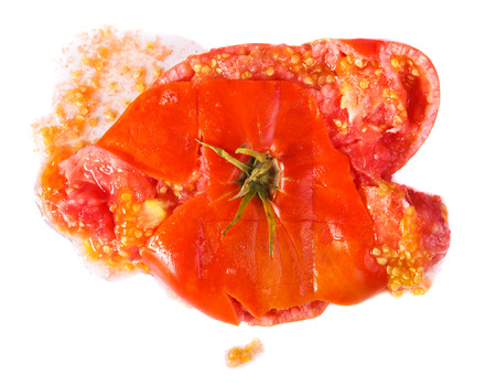 unhappiness: crushed tomatoes isolated on white background