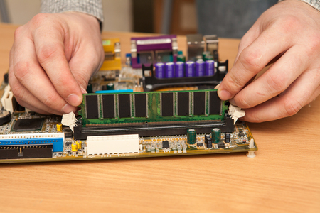 computer transistors: Master sticks RAM into the motherboard.