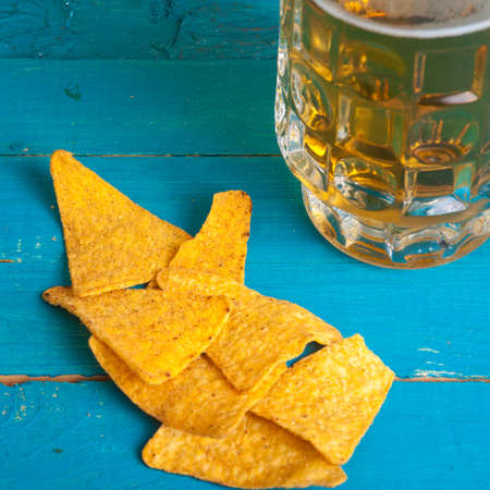 corn chips: corn chips and a mug of beer on the table Stock Photo