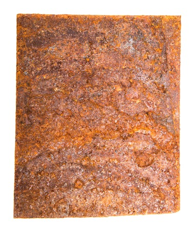 square sheet of iron covered with rust.