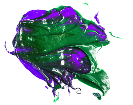 spot of green purple oil paint on a white