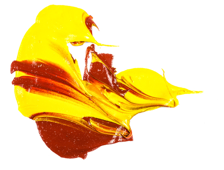 spot of yellow and red oil paint. smear on white Фото со стока