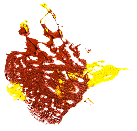 spot of yellow and red oil paint. smear on white background Фото со стока