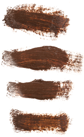 Smear of brown paint isolated on white. Set