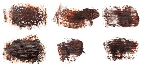 Stain of oil brown paint on white. Set Imagens