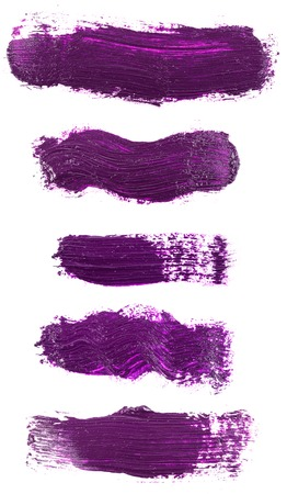 Smear of violet paint isolated on white. Set
