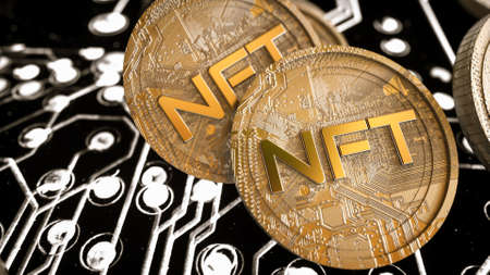 stack of three-dimensional silver coins with the inscription nft on a black background. crypto art concept. 3d render illustration