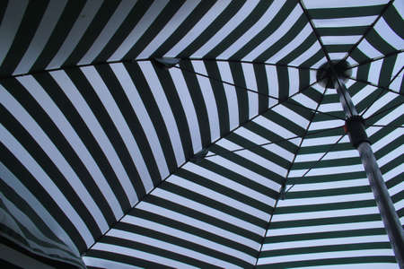 Photo of the inside of a very colourful umbrella. photo