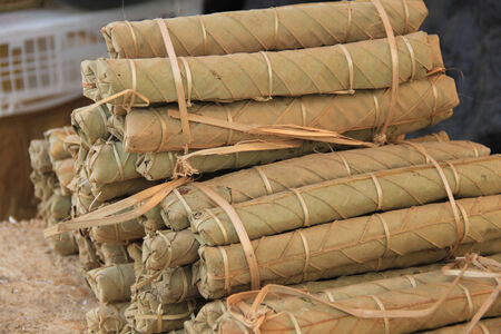 a lot of Torch package with leaf for sell in Lao. Photo taken on: March 12th, 2014 photo