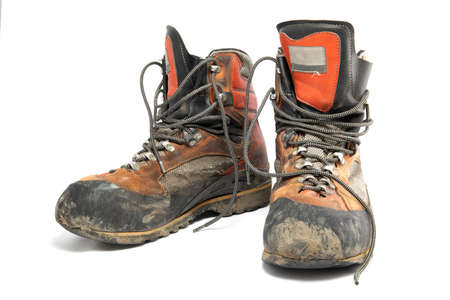 a pair of: Pair of worn hiking boots Stock Photo