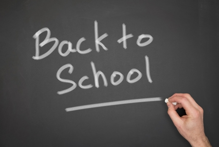 returning: Blackboard with a back to school wrote on it