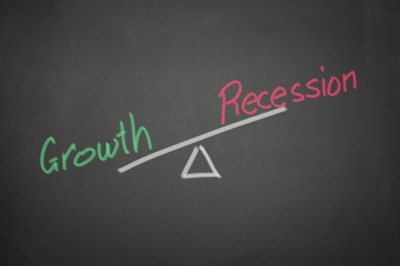 A drawing depicting the balance of growth and recession on a blackboard  photo
