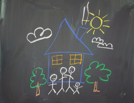 A childs drawing of a happy family at home  photo