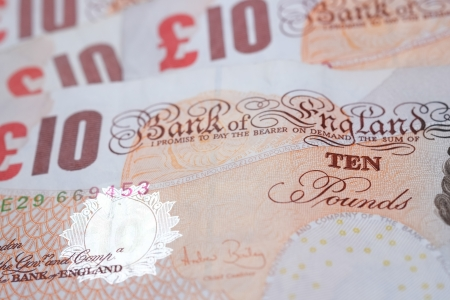 Ten pound notes spread out on a table