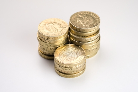 Three Piles of Pound Coins on a Table photo