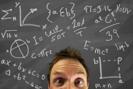 Mans head with a confused expression with equations on a blackboard