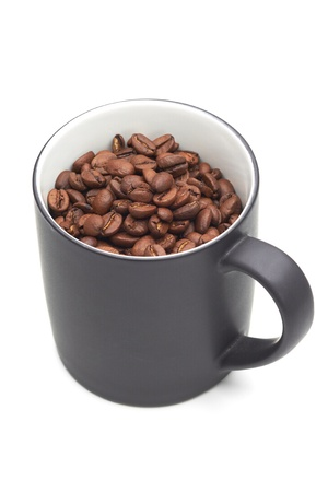 expresso: Grey mug with coffee beans in it on a white isolated background. Stock Photo