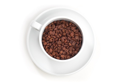 coffees: White mug with coffee beans in it on a white isolated background.