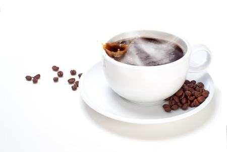 hot coffees: White Cup of Coffee with beans on a white isolated background. Stock Photo