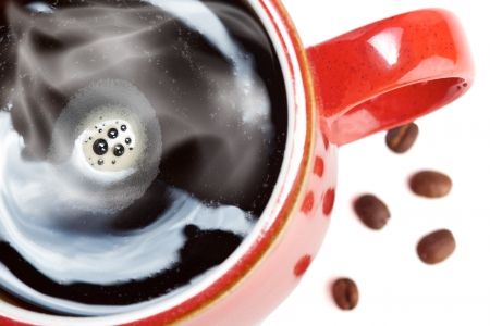 hot coffees: Red Cup of Coffee with beans on a white isolated background. Stock Photo