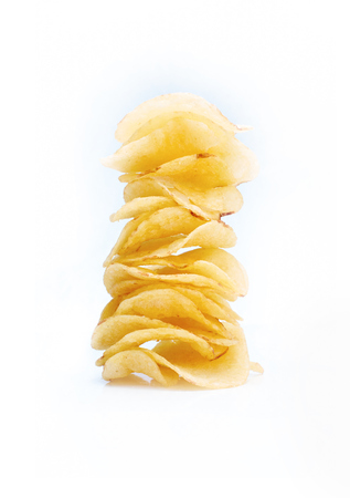 A selection of salted crisps on a white background.