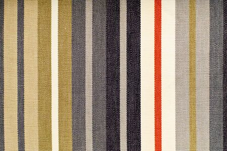 stripped: A stripped coloured fabric background.