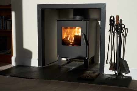 Wood burning stove, traditional heating system  Zero carbon footprint Editorial