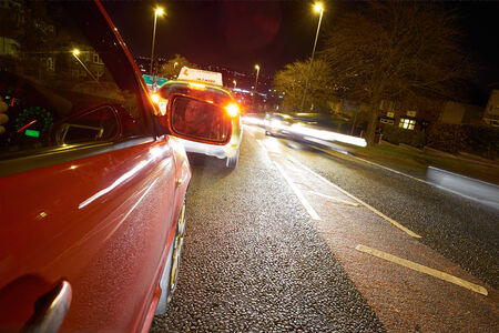 Learner driver on a busy road at night. photo