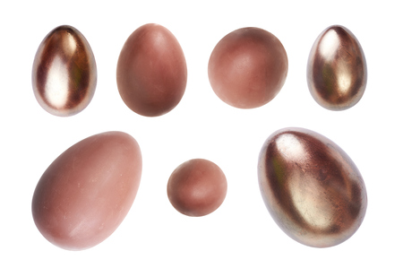 A selection of chocolate Easter Eggs on a white background  photo