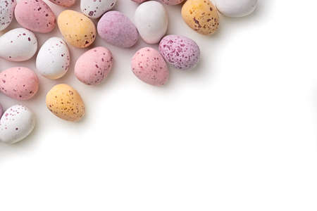 A selection of chocolate Easter Eggs with a candy crunchy shell on a white background  photo