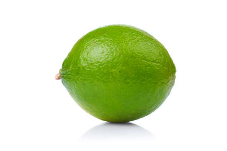 A whole fresh lime isolated on a white background. photo