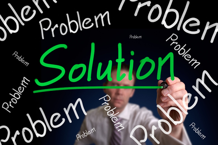 A businessman drawing a, no matter how big or small the problem is theres always a solution. photo