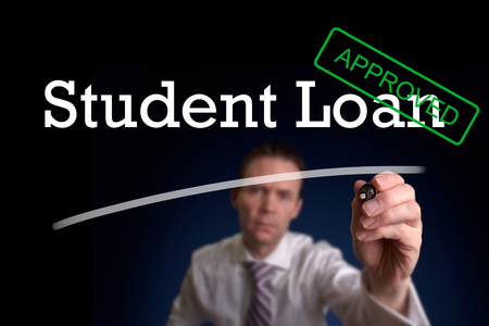 underwriter: An underwriter writing Student Loan approved on a screen.