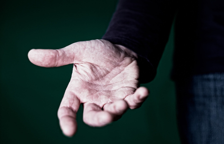 A hand reaching out to offer help. photo