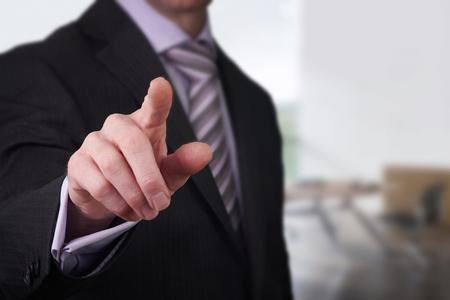 on fingers: Un hombre de negocios que apunta con el dedo a usted.