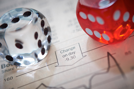 Stocks and shares Trading. Coloured dice on top of the financial section of a newspaper. photo