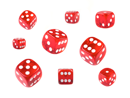 A collection of red dice at different angles isolated on a white background. Stockfoto