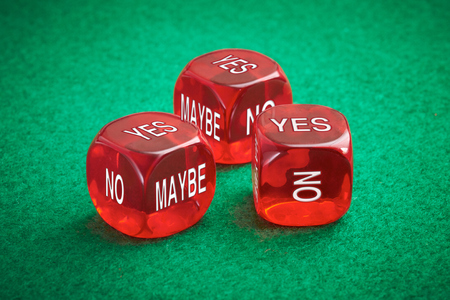 Chance concept, three red dice on a green felt background. Stock Photo